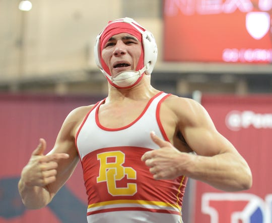Bergen Catholic's AJ Ferrari is called for unsportsman like conduct as he taunts Paulsboro fans after pinning Paulsboro's Flynn Leaf in the 220-pound bout during a wrestling match at The Palestra in Philadelphia, Saturday, Feb. 2, 2019.