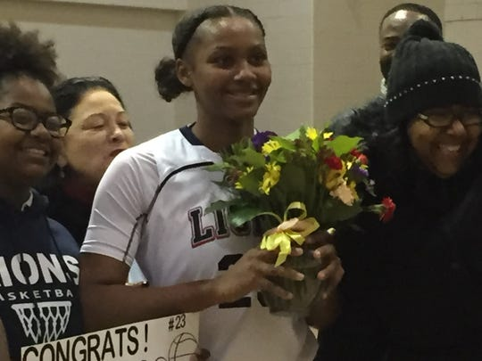 LEAP Academy senior Brazil Harvey-Carr celebrates after scoring her 2,000th career point during Friday's win over Paulsboro.