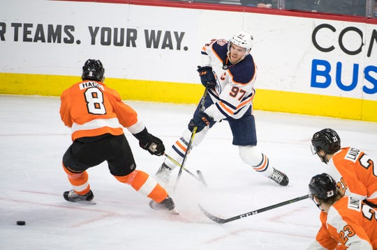 Oilers' Connor McDavid (97) fires the puck past Flyers' Robert Hagg (8) Saturday, Feb. 2, 2019 at the Wells Fargo Center in Philadelphia, Pa. Flyers won 5-4 in overtime.