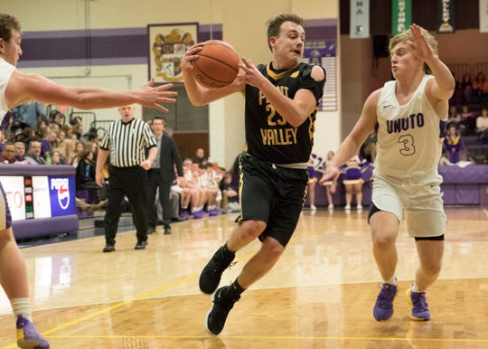 Caden Grubb attempts to drive the ball past Unioto Friday night at Unioto High School. Grubb went on to hit a lay up to give the win for Paint Valley.