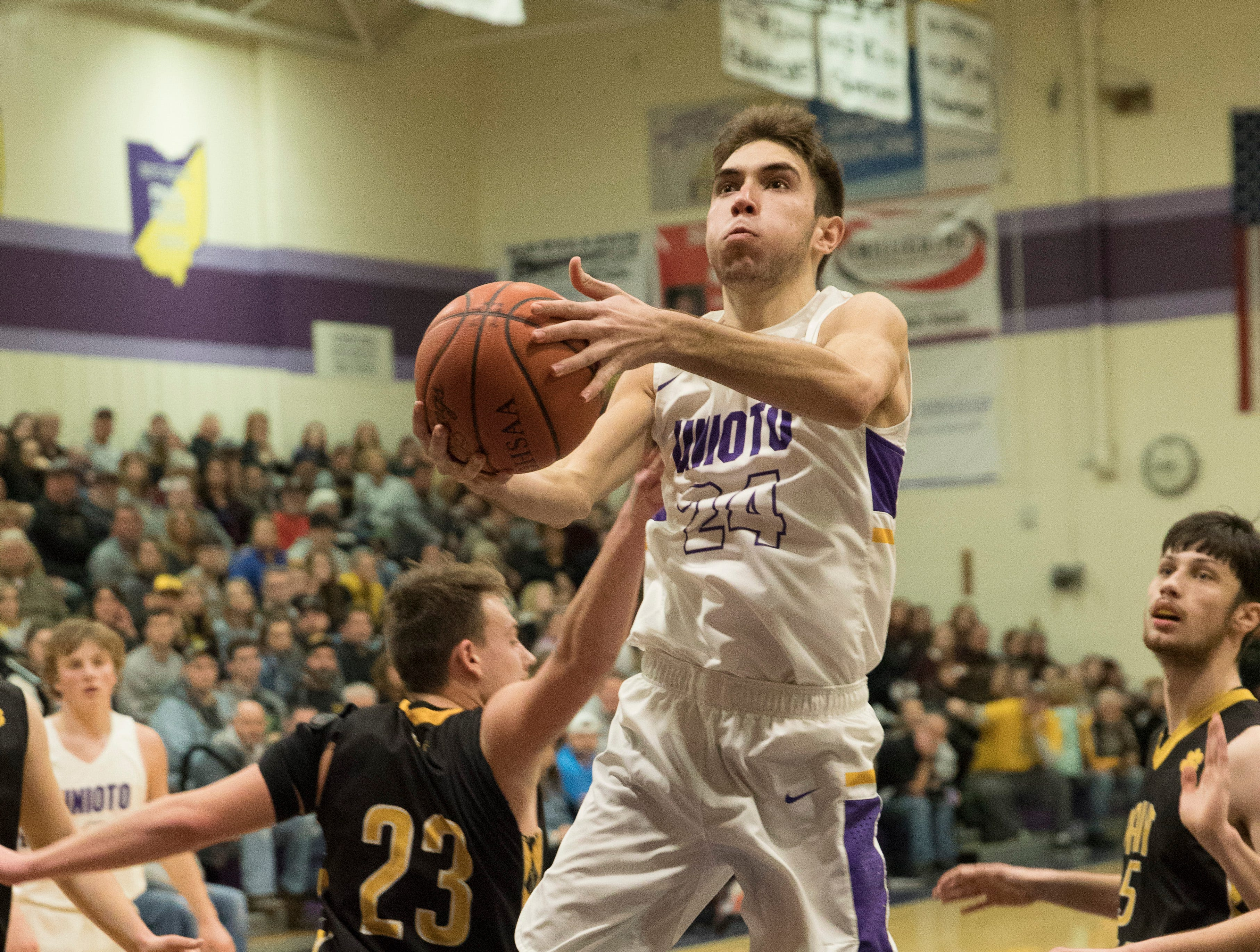 Unioto's Cade McKee makes a two-point shot against Paint Valley Friday at Unioto High School.