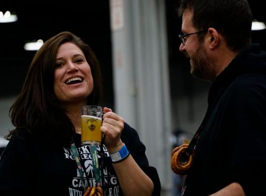 Danielle and Nick Hayes at their 5th consecutive Cincy Winter Beerfest at the Duke Energy Convention Center, Saturday, Feb. 2, 2019. The couple usually celebrates Valentines Day at Beerfest but maintained the tradition despite the festival being rescheduled to Feb. 1-2.