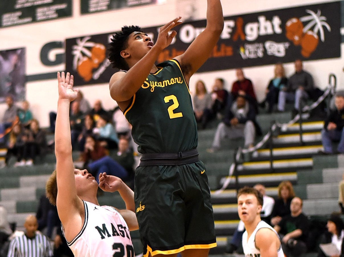 Chauncey Grandison (2) drops in a layup for Sycamore in the Third Annual Live for Liz Fight For Cancer Free Kids Basketball Game, Feb. 1, 2019.