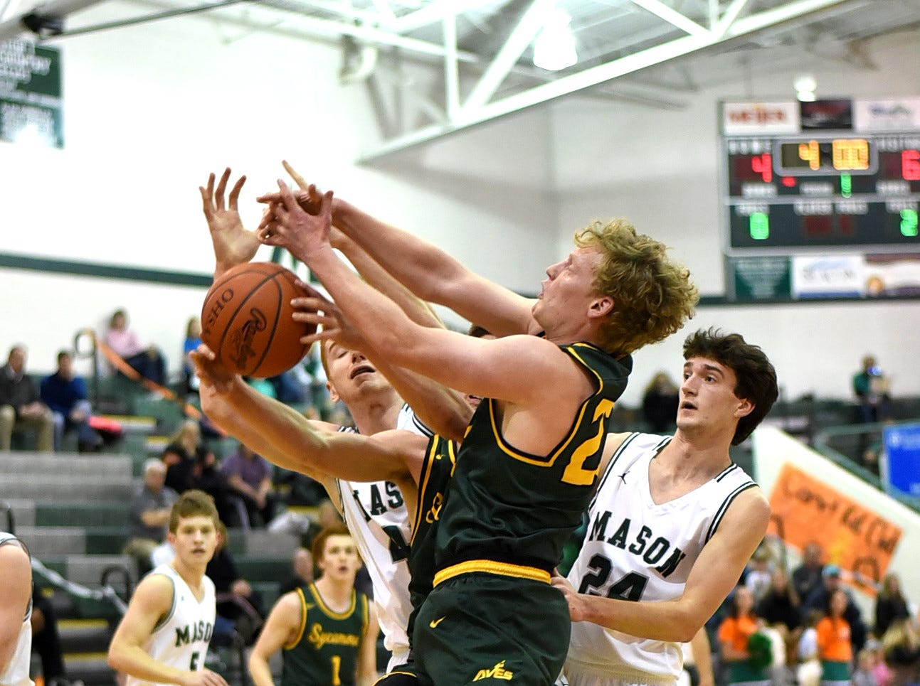 Matt Bolger (20) of Sycamore leads a fight for a rebound in the Third Annual Live for Liz Fight For Cancer Free Kids Basketball Game, Feb. 1, 2019.