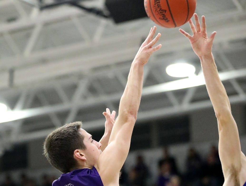 Elder guard Willard Cluxton shoots the ball during their basketball game against St. Xavier Friday, Feb. 1,2019.