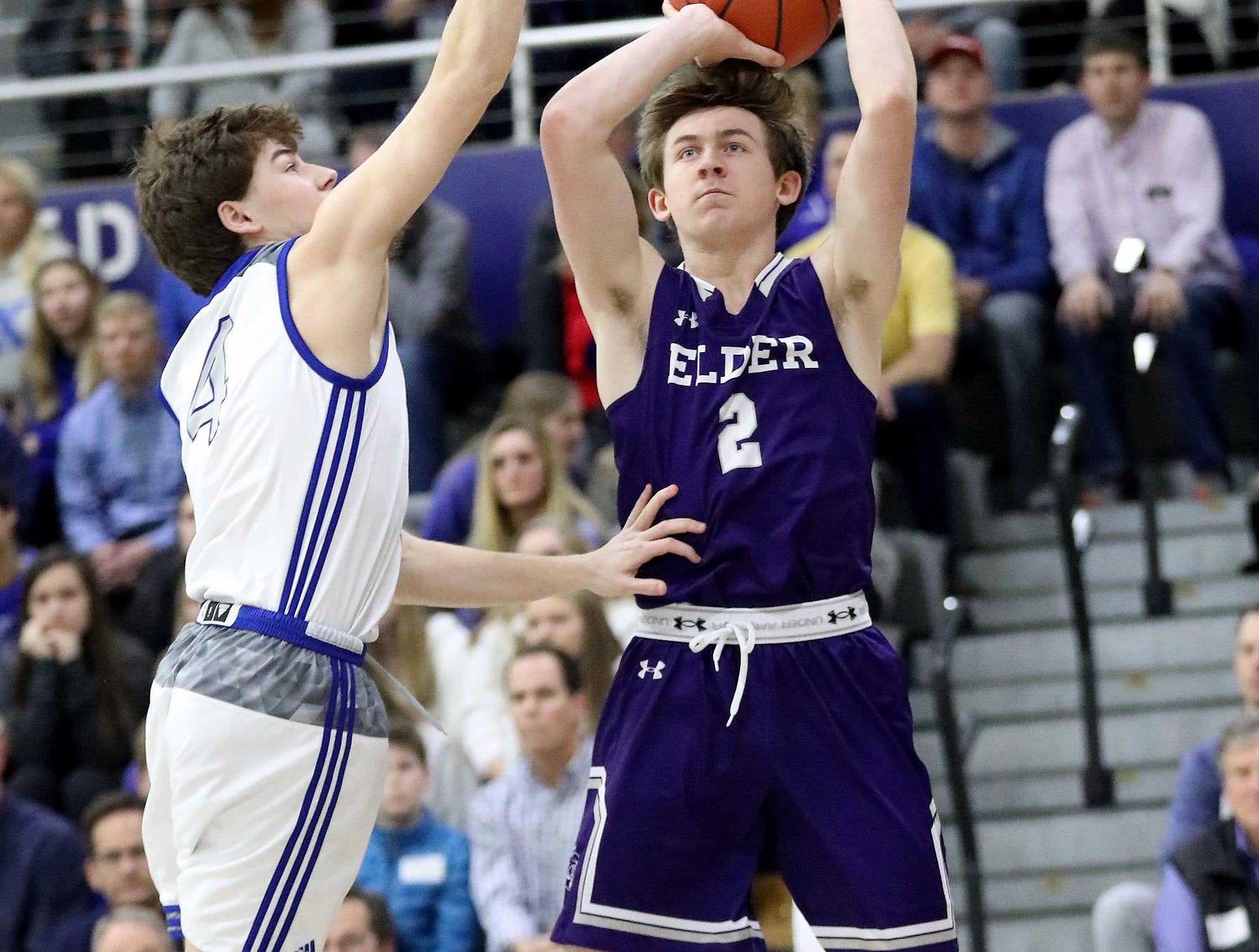 Elder guard Aiden Byrne (2) shoots the ball over St. Xavier guard Nick Frank during their basketball game Friday, Feb. 1, 2019. He scored a team-high 12 points in the 51-36 win.
