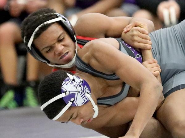 Lasalle wrestler Antoine Allen  battles Middletown wrestler   Christian Shabazz  during the Division 1 team tournament at Lakota East High School, Saturday, Feb. 2,2019.