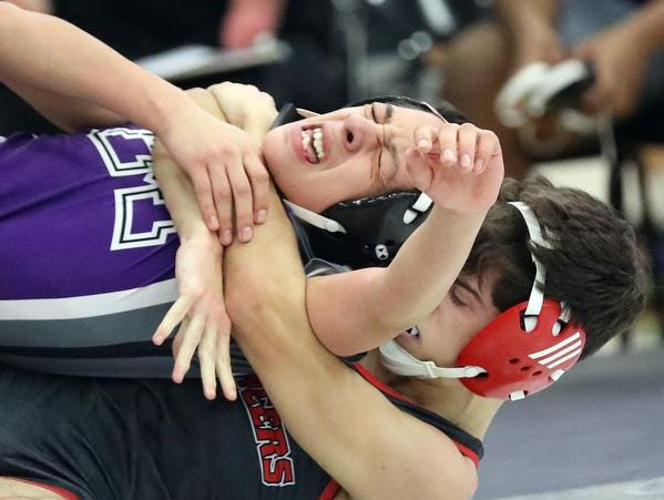 Lasalle wrestler Patrick Meier battles Middletown wrestler  Joesph Oviedo during the Division 1 team tournament at Lakota East High School, Saturday, Feb. 2,2019.