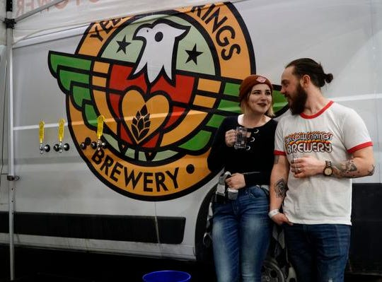 Hailey and Cody Petkus of Yellow Springs Brewery at the Cincy Winter Beerfest in the Duke Energy Convention Center, Saturday, Feb. 2, 2019.