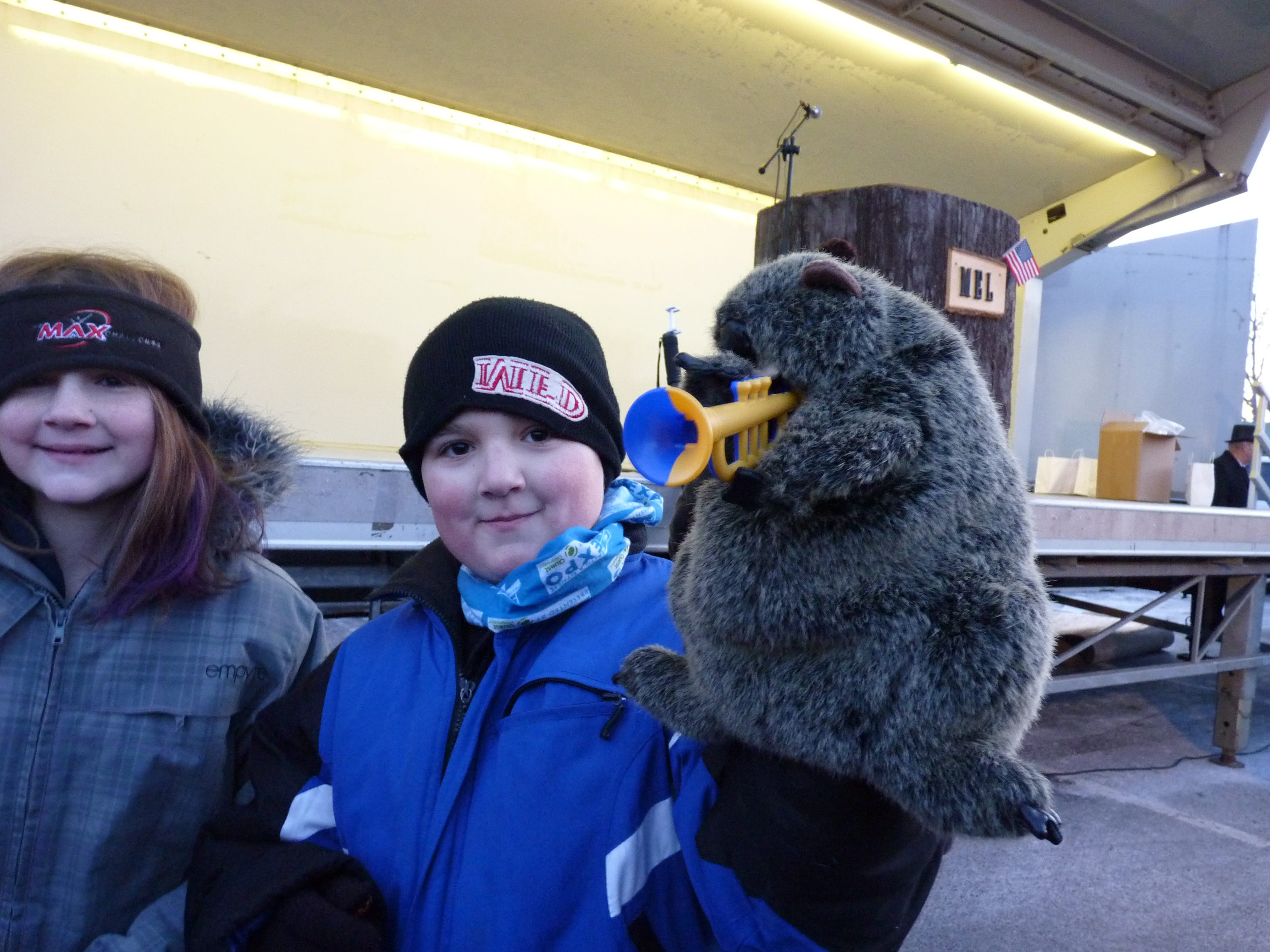 Attendees playing with groundhog props on Groundhog Day in Milltown.