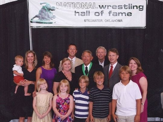 Ken Pagach with his family following his induction to the National Wrestling Hall of Fame in Stillwater, Oklahoma