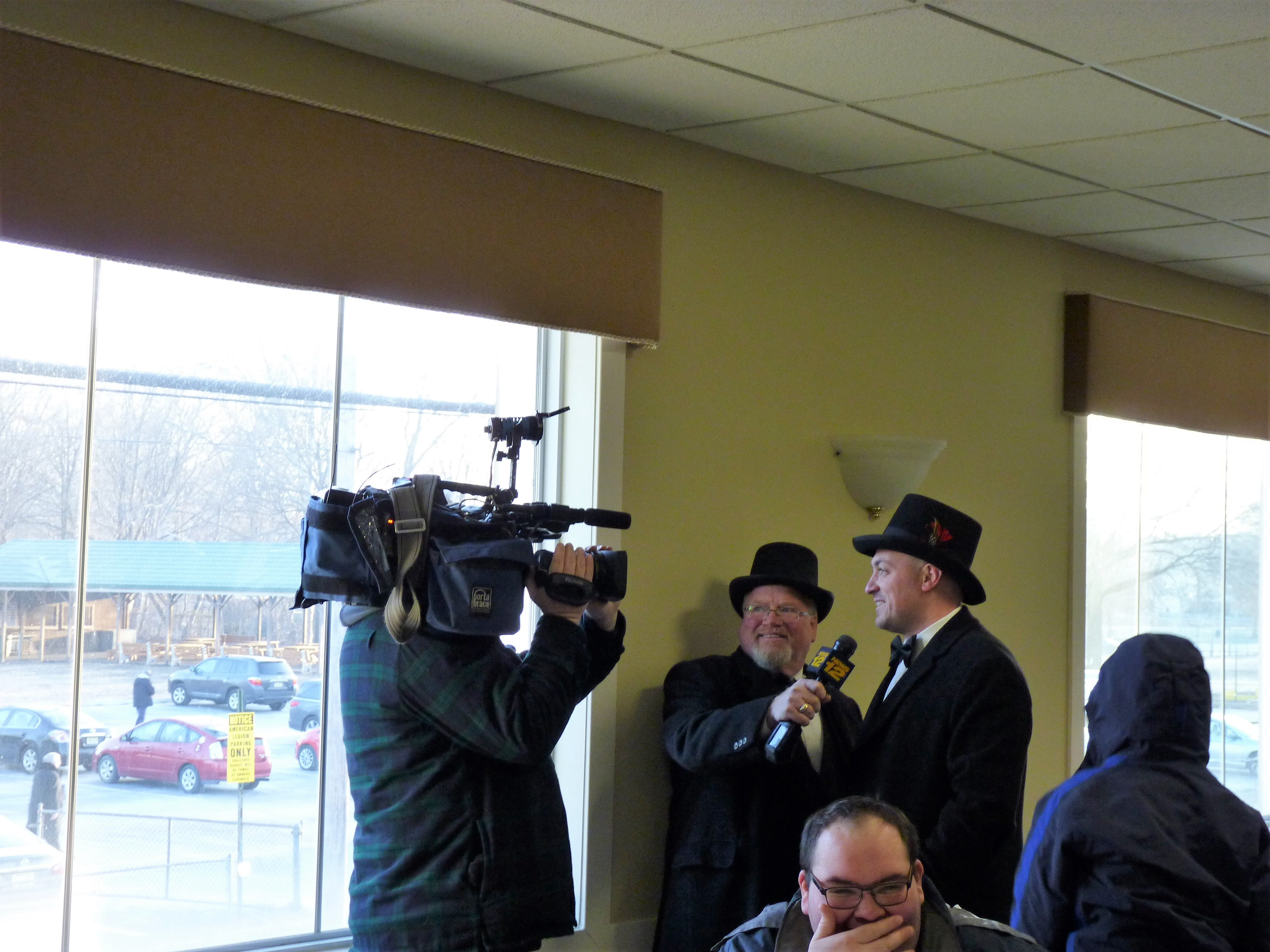Groundhog wranglers speaking to the press after the Groundhog Day prediction.