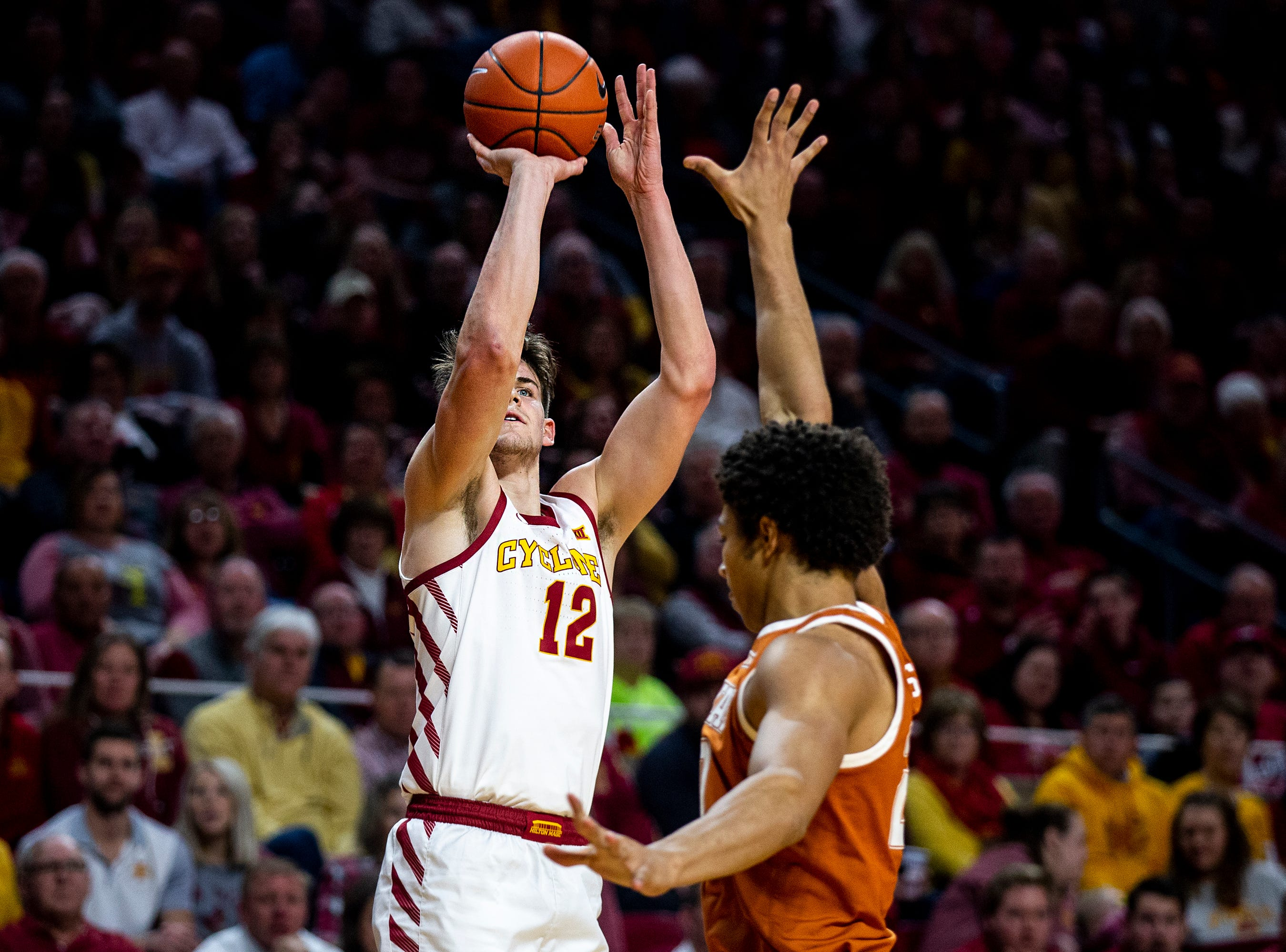 Iowa State's Michael Jacobson shoots a three-pointer during the Iowa State men's basketball game against Texas on Saturday, Feb. 2, 2019, in Hilton Coliseum.