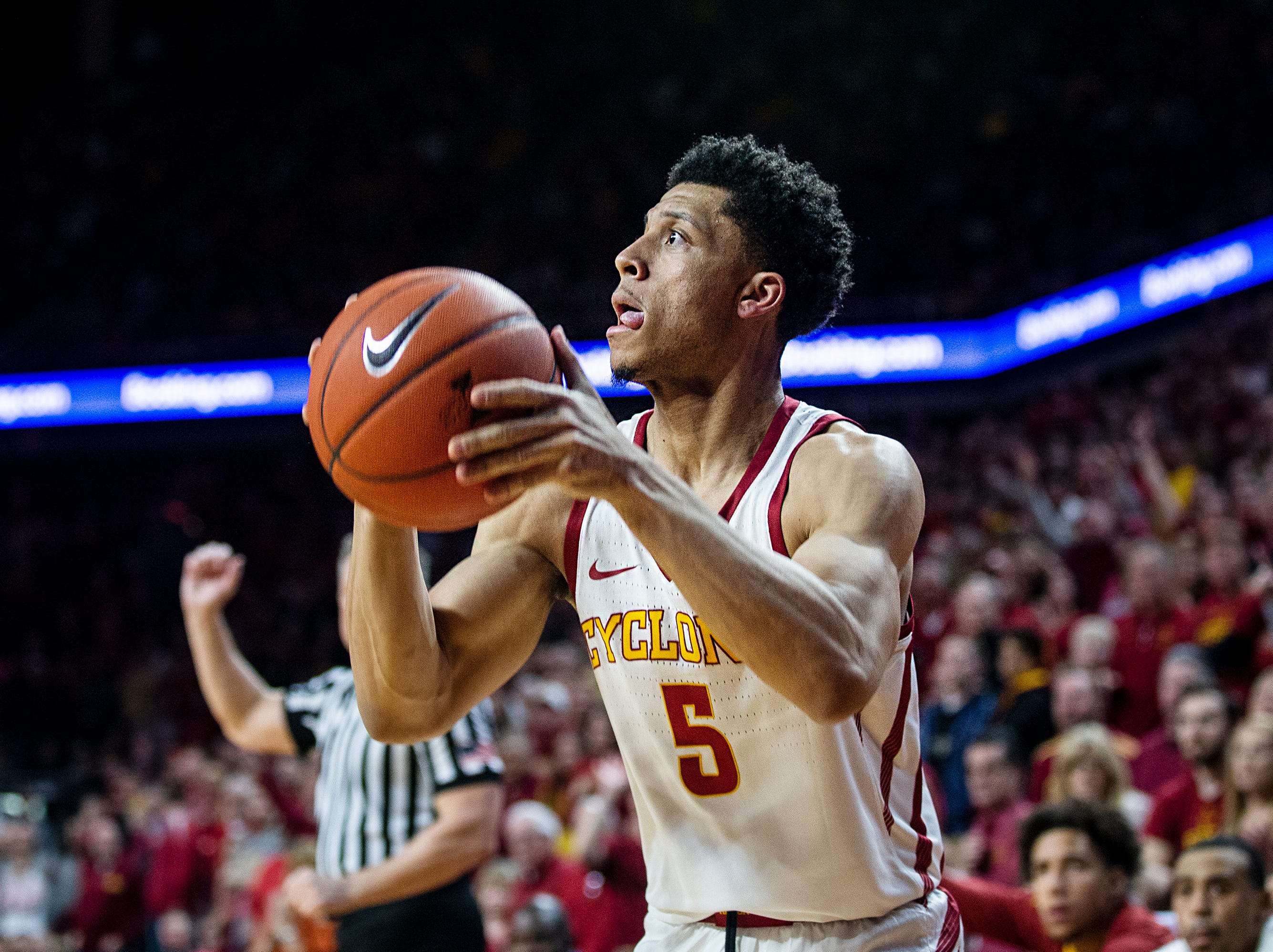 Iowa State's Lindell Wigginton shoots a three-point shot during the Iowa State men's basketball game against Texas on Saturday, Feb. 2, 2019, in Hilton Coliseum. The Cyclones defeated the Longhorns 65-60.
