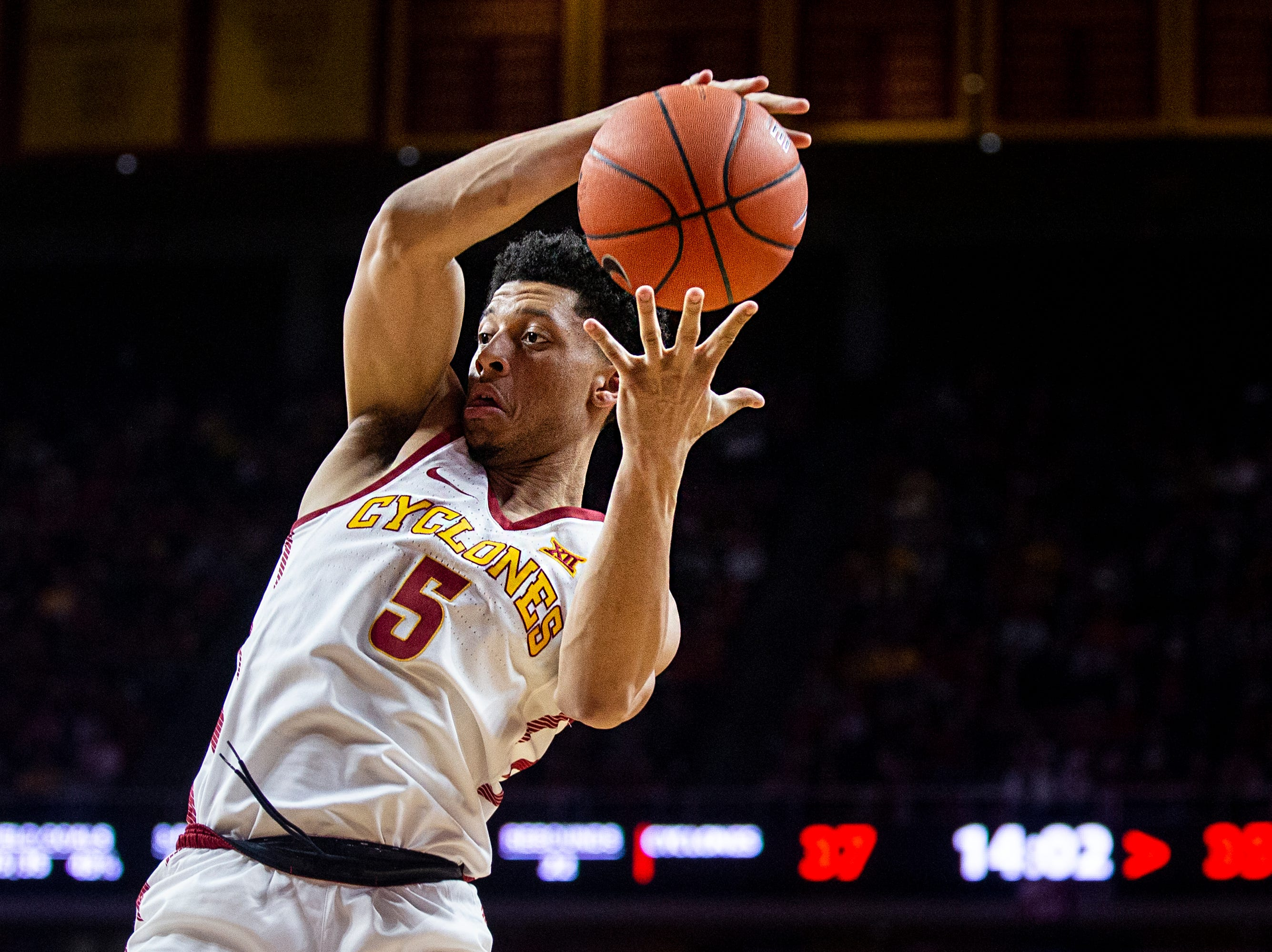 Iowa State's Lindell Wigginton tries to hold on to the ball during the Iowa State men's basketball game against Texas on Saturday, Feb. 2, 2019, in Hilton Coliseum. The Cyclones defeated the Longhorns 65-60.