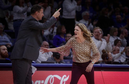 Missouri State women's basketball coach Kellie Harper instructs an assistant coach to return to the bench area after a call against the Lady Bears in the second quarter against Drake on Friday, Feb. 1, 2019, at Knapp Auditorium in Des Moines.