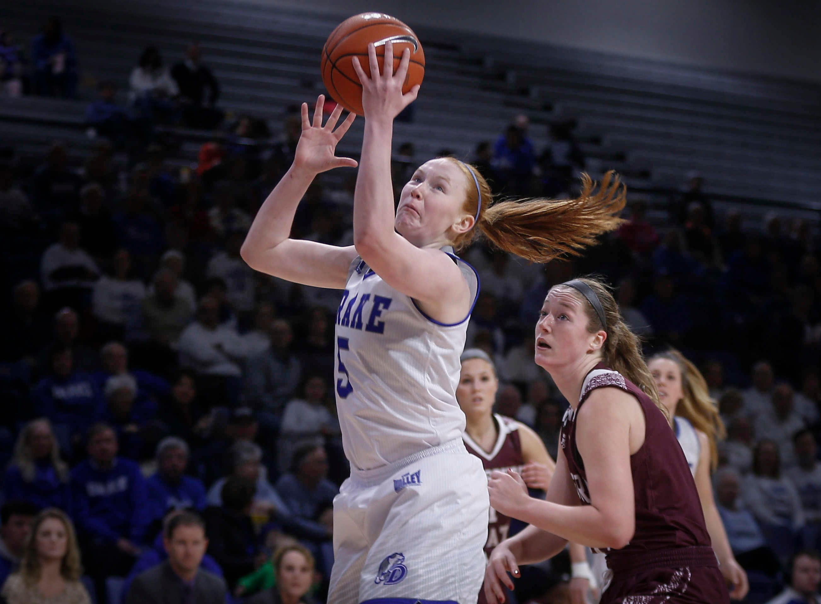 Drake junior Becca Hittner drives to the hoop against Missouri State on Friday, Feb. 1, 2019, at Knapp Auditorium in Des Moines.