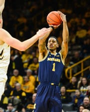 Michigan guard Charles Matthews shoots against Iowa during the first half Feb. 1, 2019 in Iowa City, Iowa.