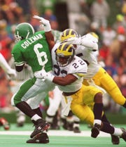 Michigan's Ty Law tries to tackle MSU's Mill Coleman on Oct. 9, 1993.