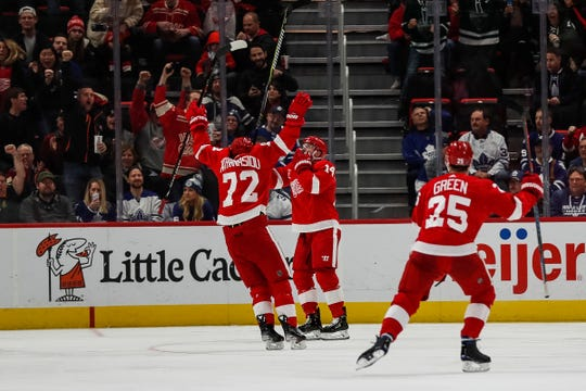 Red Wings forward Gustav Nyquist (14) celebrates his goal against Maple Leafs with forward Andreas Athanasiou (72) during the second period at the Little Caesars Arena in Detroit, Friday, Feb. 1, 2019.