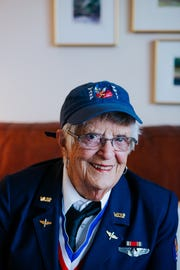 FILE -- Mildred (Jane) Doyle, a member of the Women Airforce Service Pilots during World War II, poses for a portrait in her WASP dress uniform at her Grand Rapids, Michigan, home on Nov. 7, 2017. Doyle flew military planes in support missions for the U.S. military.