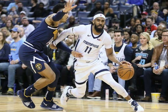 Grizzlies guard Mike Conley drives against Nuggets guard Gary Harris at FedExForum, Jan. 28, in Memphis, Tenn.