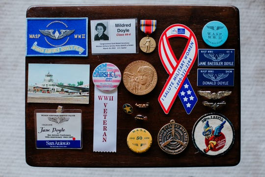 FILE -- Medals, badges, buttons and pins including a Congressional Gold Medal, center, and World War II Victory Medal, top center, that were awarder to Mildred (Jane) Doyle, a member of the Women Airforce Service Pilots during World War II,  photographed at her Grand Rapids, Mich. home on Nov. 7, 2017.