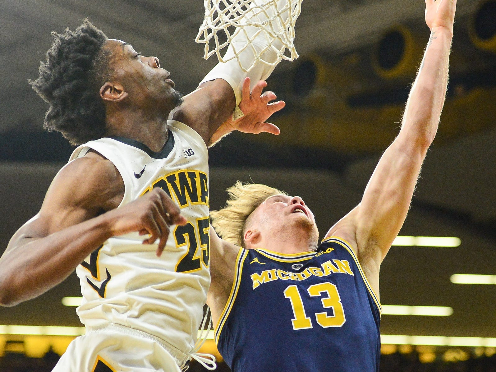 Michigan forward Ignas Brazdeikis shoots as Iowa forward Tyler Cook defends during the first half Feb. 1, 2019 in Iowa City, Iowa.