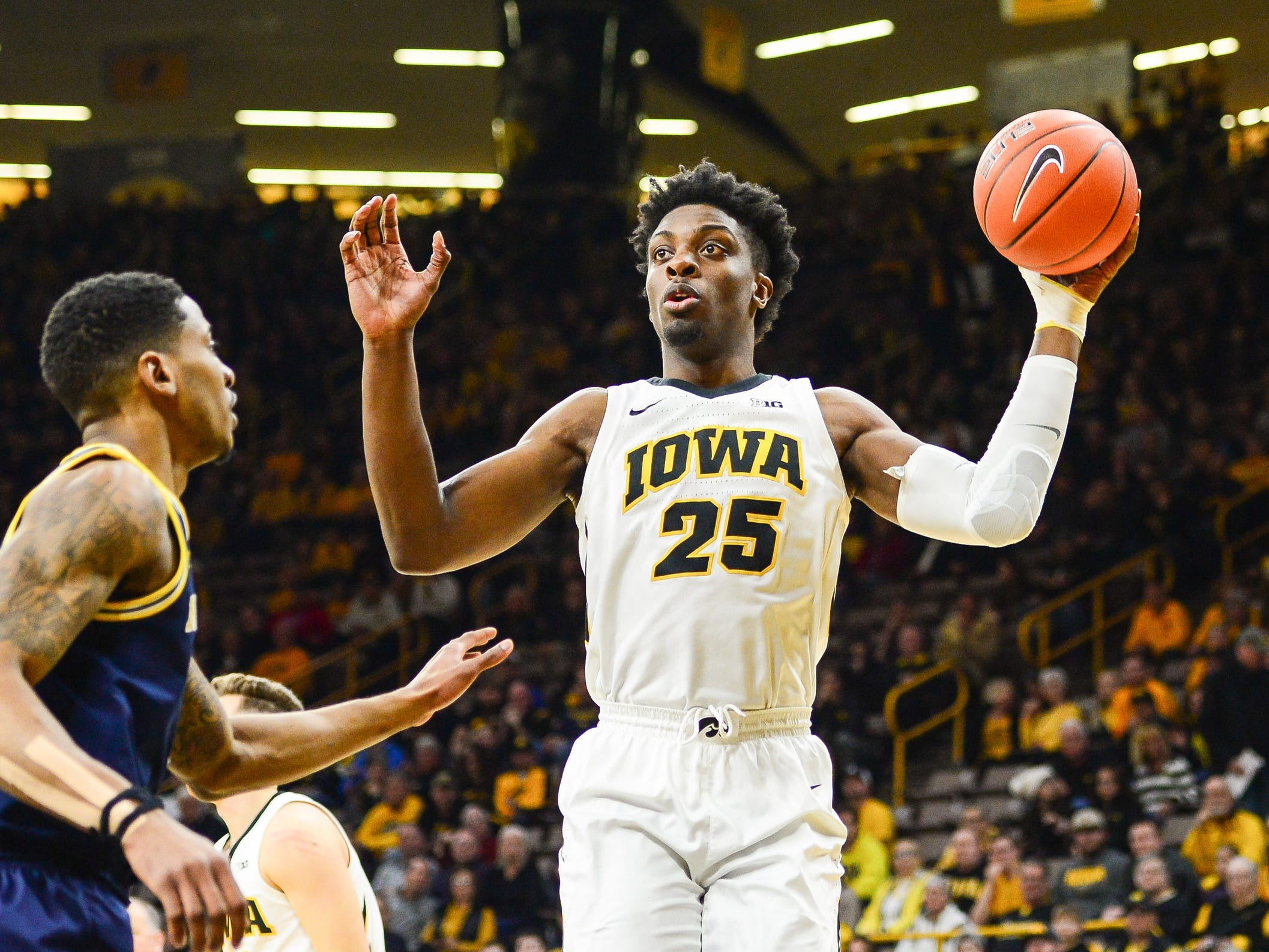 Iowa forward Tyler Cook controls the ball during the first half against Michigan, Feb. 1, 2019 in Iowa City, Iowa.