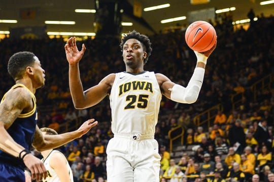 Iowa forward Tyler Cook controls the ball during the first half against Michigan, Feb. 1, 2019 in Iowa City, Iowa.