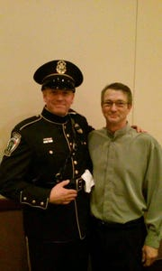 Sgt. Frank Shuler, left, with Don Jolliff at a 2015 Troy Police Department awards ceremony where Shuler was honored for his lifesaving efforts after Jolliff's truck got stuck in the snow and he suffered a heart attack on Super Bowl Sunday Feb. 1, 2015.