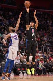 Tobias Harris shoots over Pistons guard Reggie Bullock on Saturday at LCA.