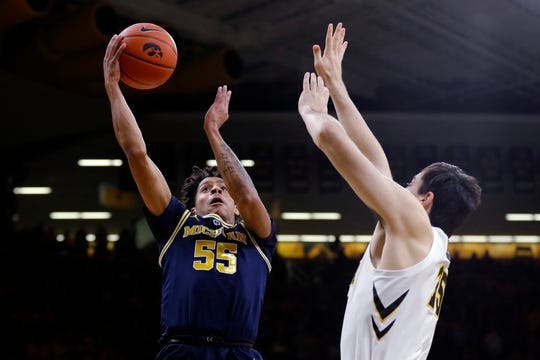 Michigan guard Eli Brooks drives to the basket against Iowa forward Ryan Kriener during the first half Friday, Feb. 1, 2019, in Iowa City, Iowa.