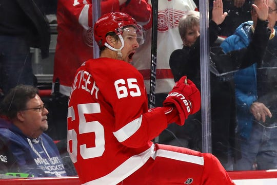 Danny DeKeyser #65 of the Detroit Red Wings celebrates his game winning overtime goal while playing the Toronto Maple Leafs at Little Caesars Arena on February 01, 2019 in Detroit, Michigan.