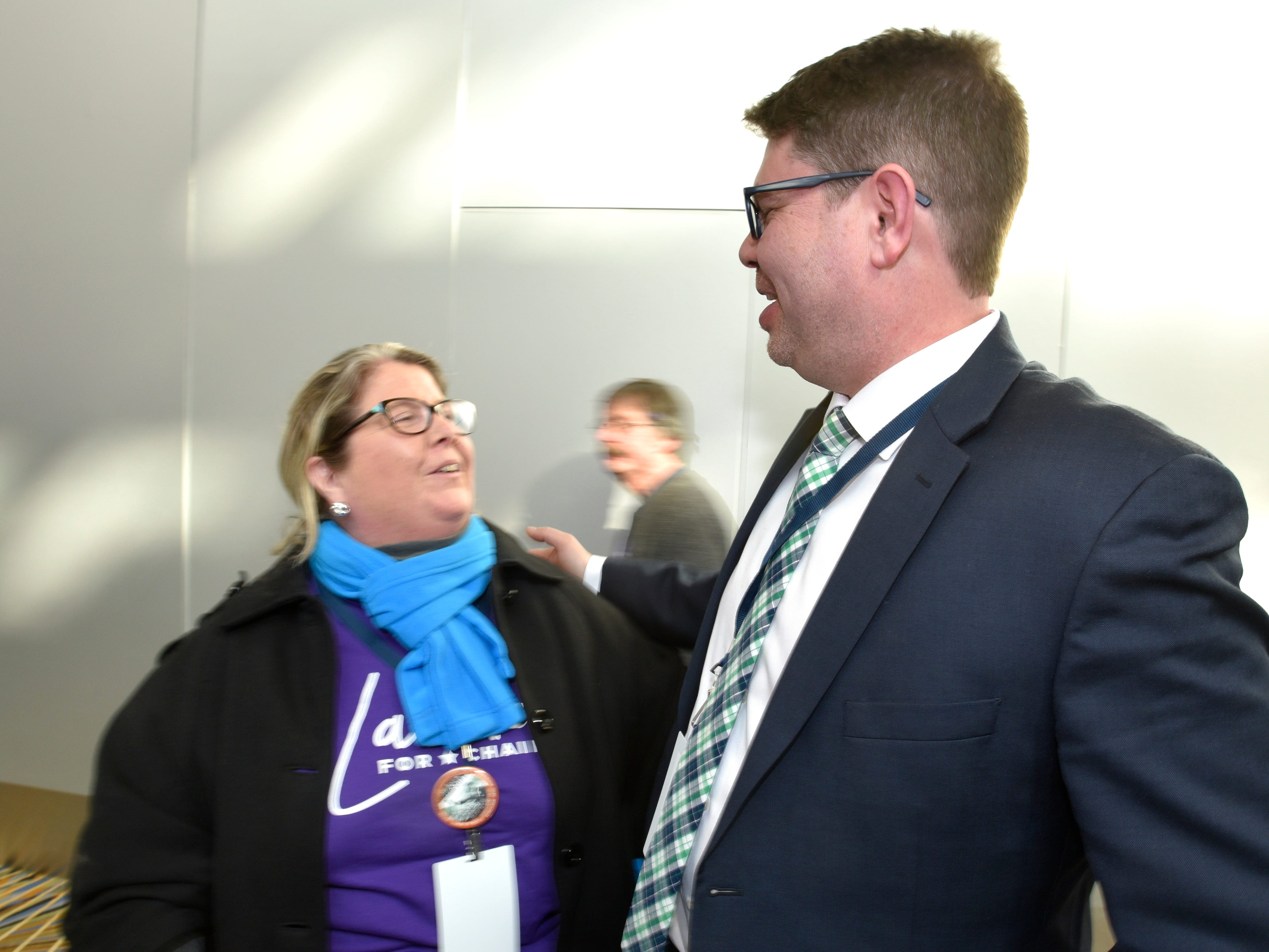 Patricia Harris, left, of Westland, talks to outgoing MI Democratic chairman Brandon Dillon as throngs of Democrats gather for the Michigan Democratic Party Spring State Convention in the Grand Riverview Ballroom at Cobo Center, Saturday afternoon, February 2, 2019.