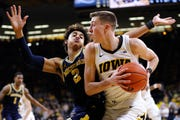 Iowa guard Joe Wieskamp drives past Michigan guard Jordan Poole during the second half.