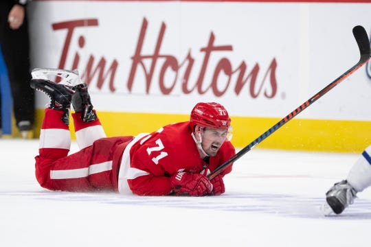 Detroit center Dylan Larkin hits the ice after being injured during the overtime period.