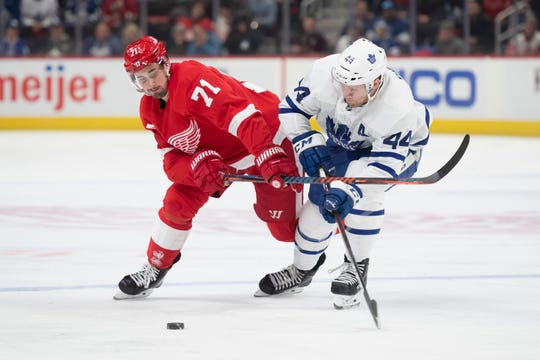 Detroit center Dylan Larkin and Toronto defenseman Morgan Rielly battle for the puck in the first period last week.