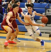 Michael Limoncelli of Horseheads drives the baseline as Brett Avery of Ithaca defends Feb. 2, 2019 at Horseheads Middle School.