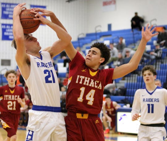 Hayden Robinson of Horseheads goes up for a shot as Ithaca's Christopher Parker defends Feb. 2, 2019 at Horseheads Middle School.