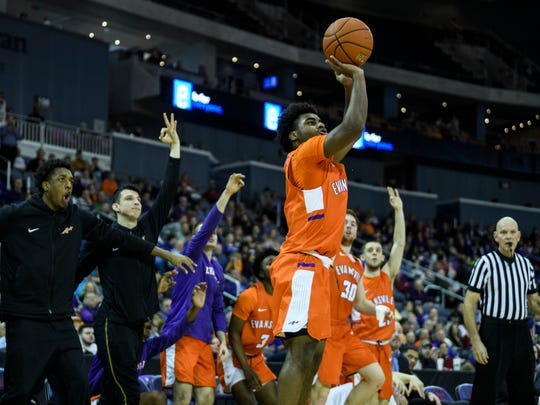 University of Evansville's Shamar Givance (5) makes a three-pointer against the Valparaiso Crusaders in the second half at Ford Center in Evansville, Ind., Saturday, Feb. 2, 2019. The Purple Aces defeated the Crusaders, 64-53.