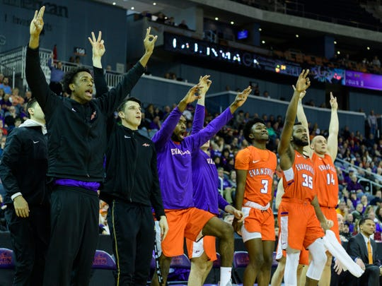 The University of Evansville Purple Aces react to their team netting another three-pointer in the second half against the Valparaiso Crusaders at Ford Center in Evansville, Ind., Saturday, Feb. 2, 2019. The Purple Aces broke their four-game losing streak by defeating the Crusaders, 64-53,