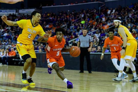 University of Evansville's Shamar Givance (5) dribbles around Valparaiso's Deion Lavender (2) during the second half at Ford Center in Evansville, Ind., Saturday, Feb. 2, 2019. The Purple Aces defeated the Crusaders, 64-53.