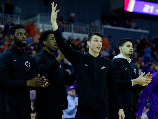 Peace Ilegomah, from left, Deandre Williams, Art Labinowicz and Sam Cunliffe watch their team play the Valparaiso Crusaders at Ford Center in Evansville, Ind., Saturday, Feb. 2, 2019. The Purple Aces defeated the Crusaders, 64-53.
