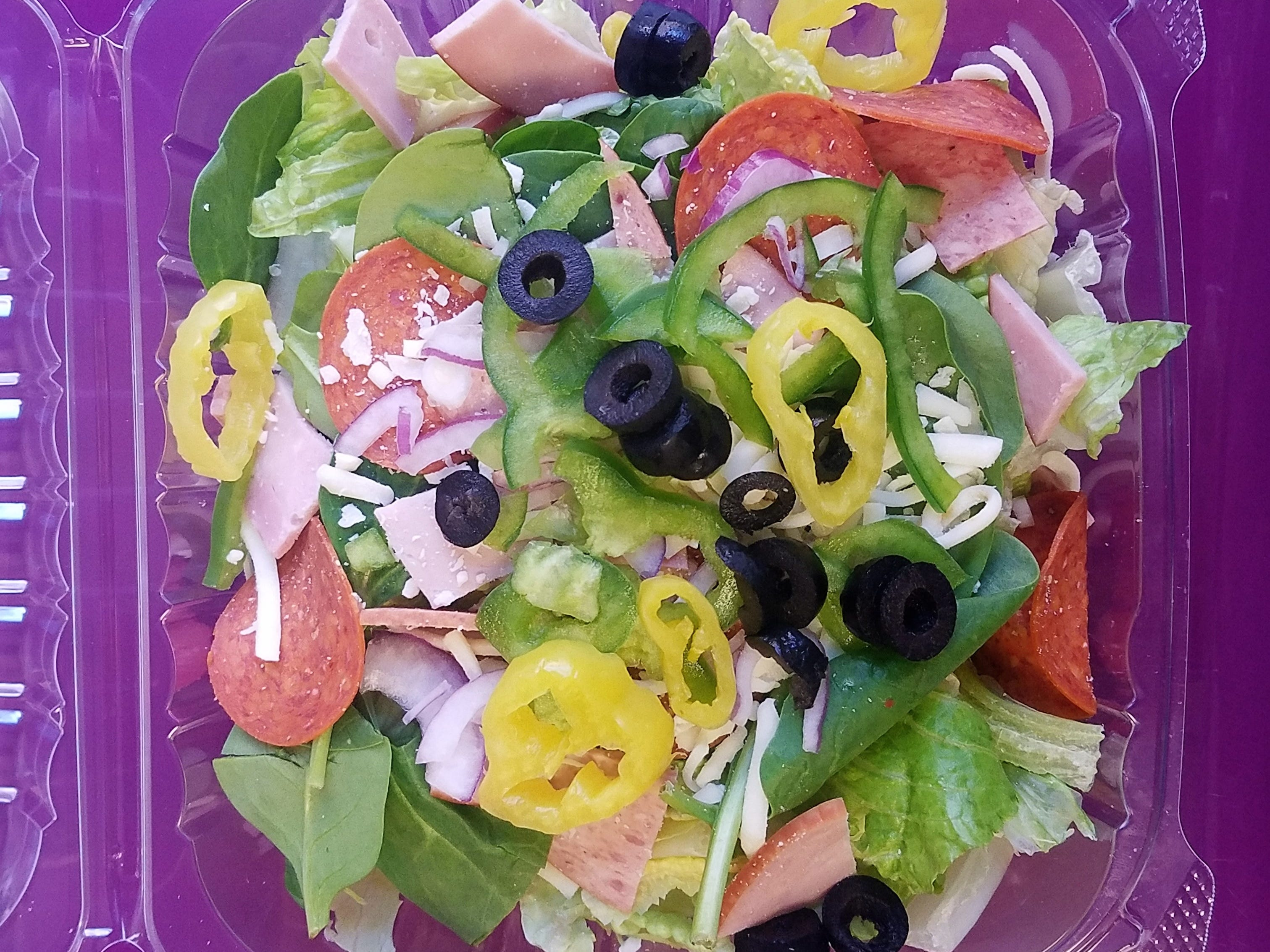 An Italian salad at Keylee's Pizza and Creamery is adorned with sliced ham, pepperoni and salami and veggie toppings of your choice.