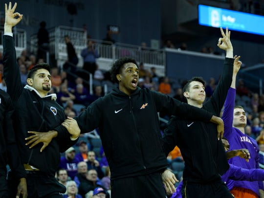 University of Evansville's Sam Cunliffe, from left, Deandre Williams and Arthur Labinowicz react to a three-pointer netted by their teammate Shamar Givance (5) during the second half against the Valparaiso Crusaders at Ford Center in Evansville, Ind., Saturday, Feb. 2, 2019. The Purple Aces defeated the Crusaders, 64-53.