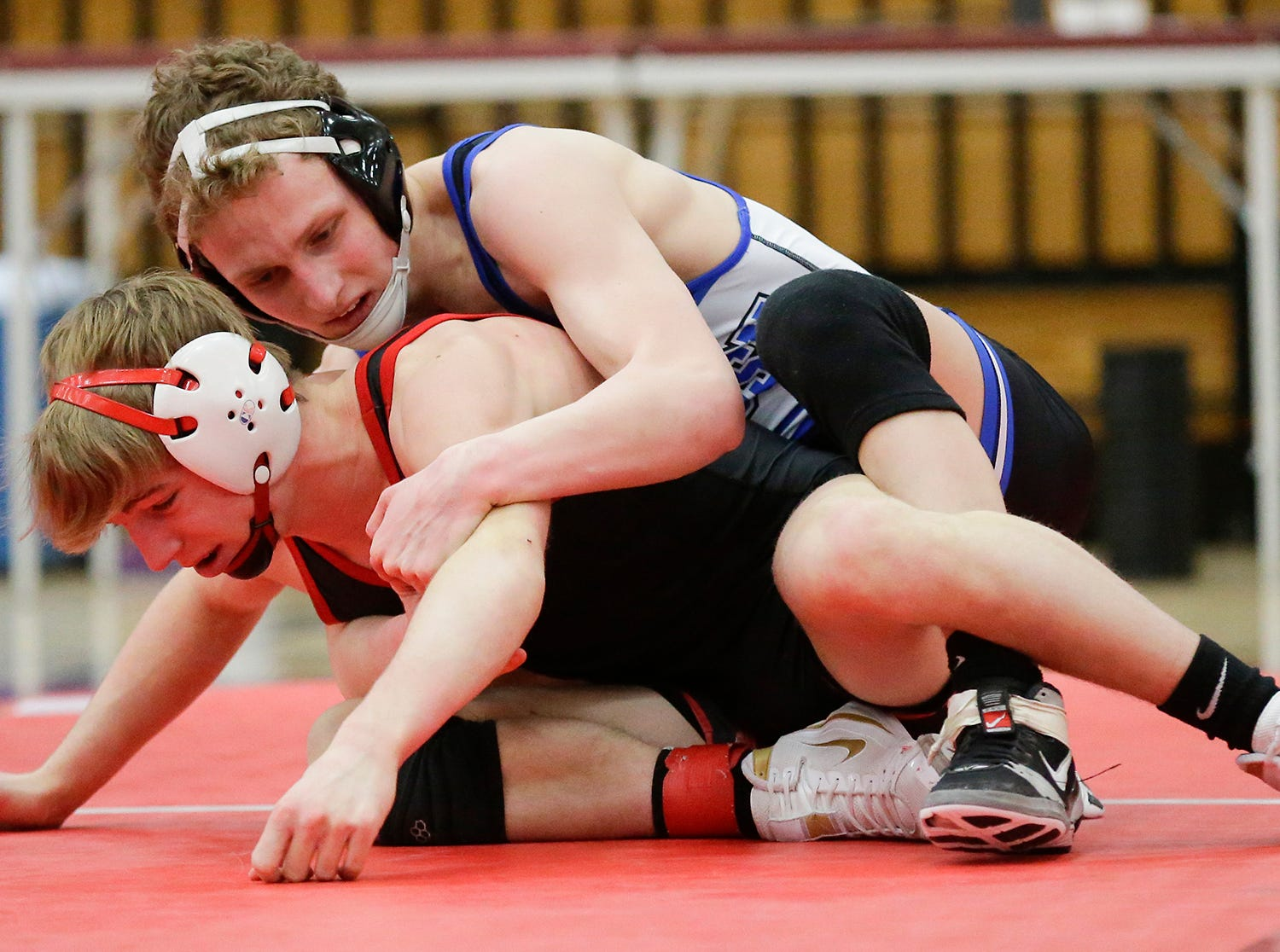 Kimberly High School's Max Sanderfoot wrestles Oshkosh West High School's Logan Grota in a 132-pound match during the Fox Valley Association wrestling championship meet held Saturday, Feb. 2, 2019, in Fond du Lac. Sanderfoot won the match by a pin.