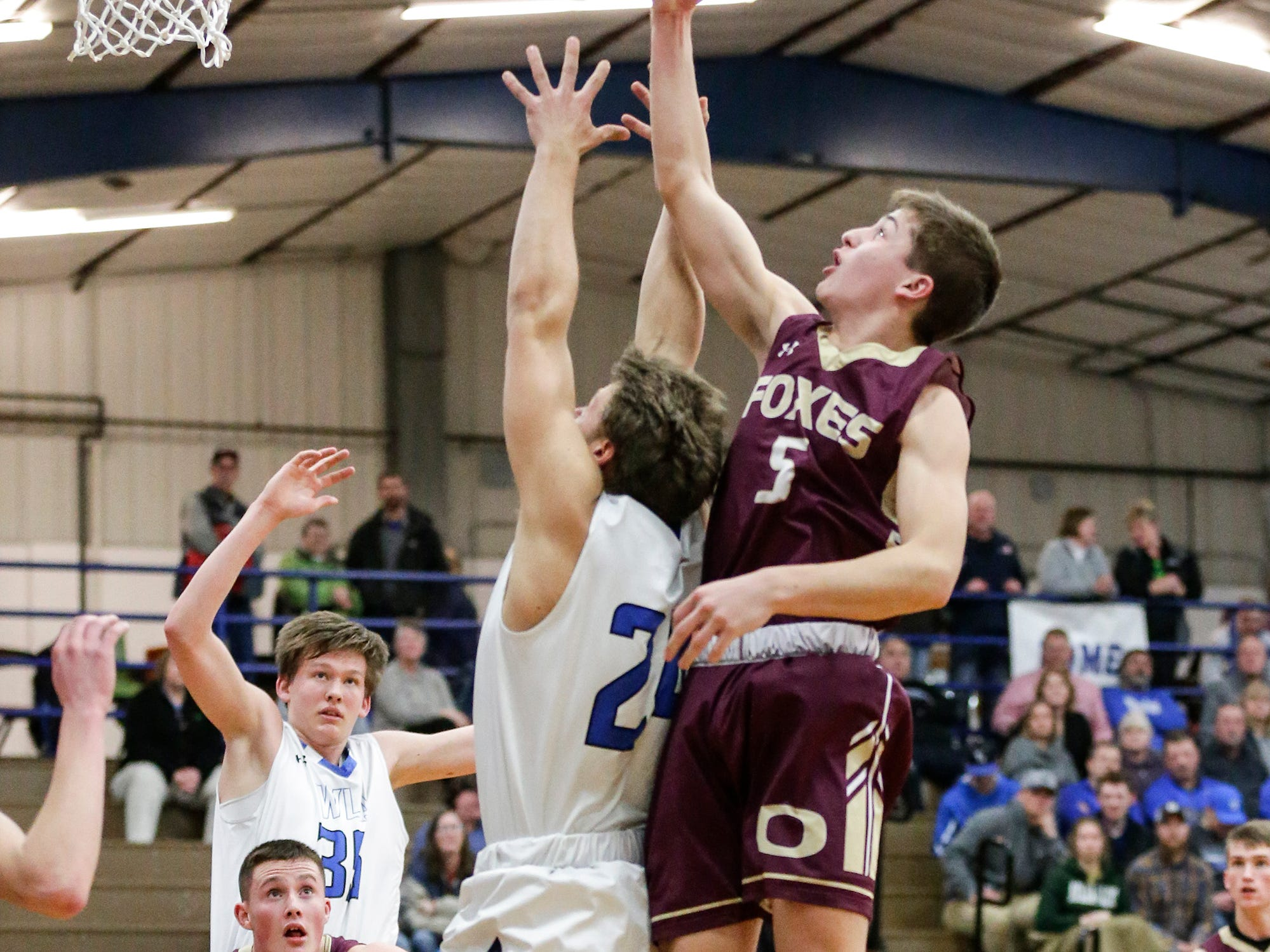 Winnebago Lutheran Academy boys basketball's Gideon Wenig (24) and Omro High School's Cody Schoeni (5) go up for a rebound during their game Friday, February 1, 2019 in Fond du Lac. Doug Raflik/USA TODAY NETWORK-Wisconsin