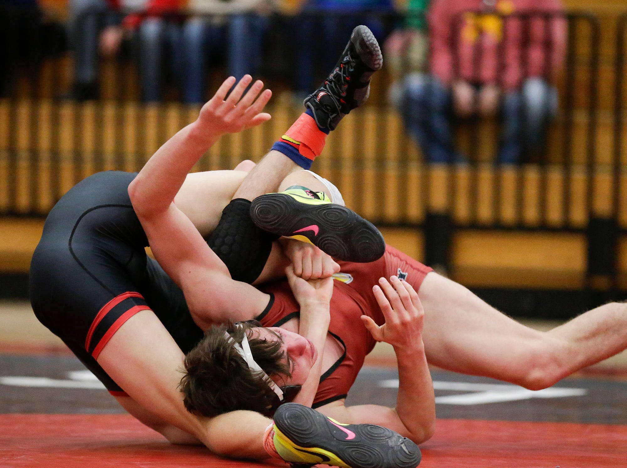 Fond du Lac High School's Logan Naker wrestles Kimberly High School's Tucker Smith in a 145 pound match during the Fox Valley Association wrestling championship meet held in Fond du Lac, Saturday, February 2, 2019. Smith won the meet by a pin. Doug Raflik/USA TODAY NETWORK-Wisconsin