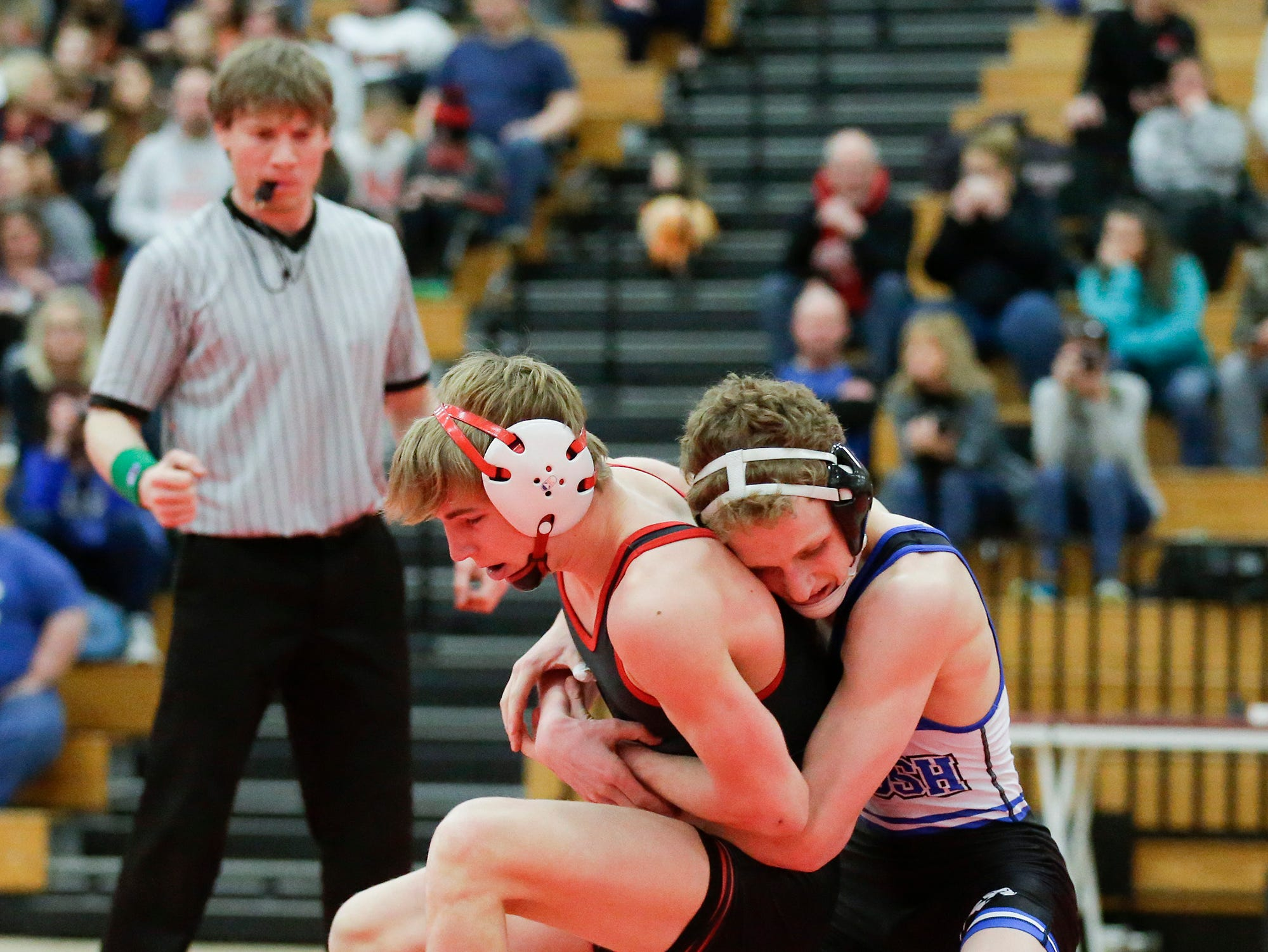 Kimberly High School's Max Sanderfoot wrestles Oshkosh West High School's Logan Grota in a 132-pound match during the Fox Valley Association wrestling championship meet held in Fond du Lac, Saturday, Feb. 2, 2019. Sanderfoot won the match by a pin.